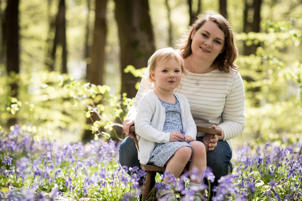 mum and daughter in bluebell woods