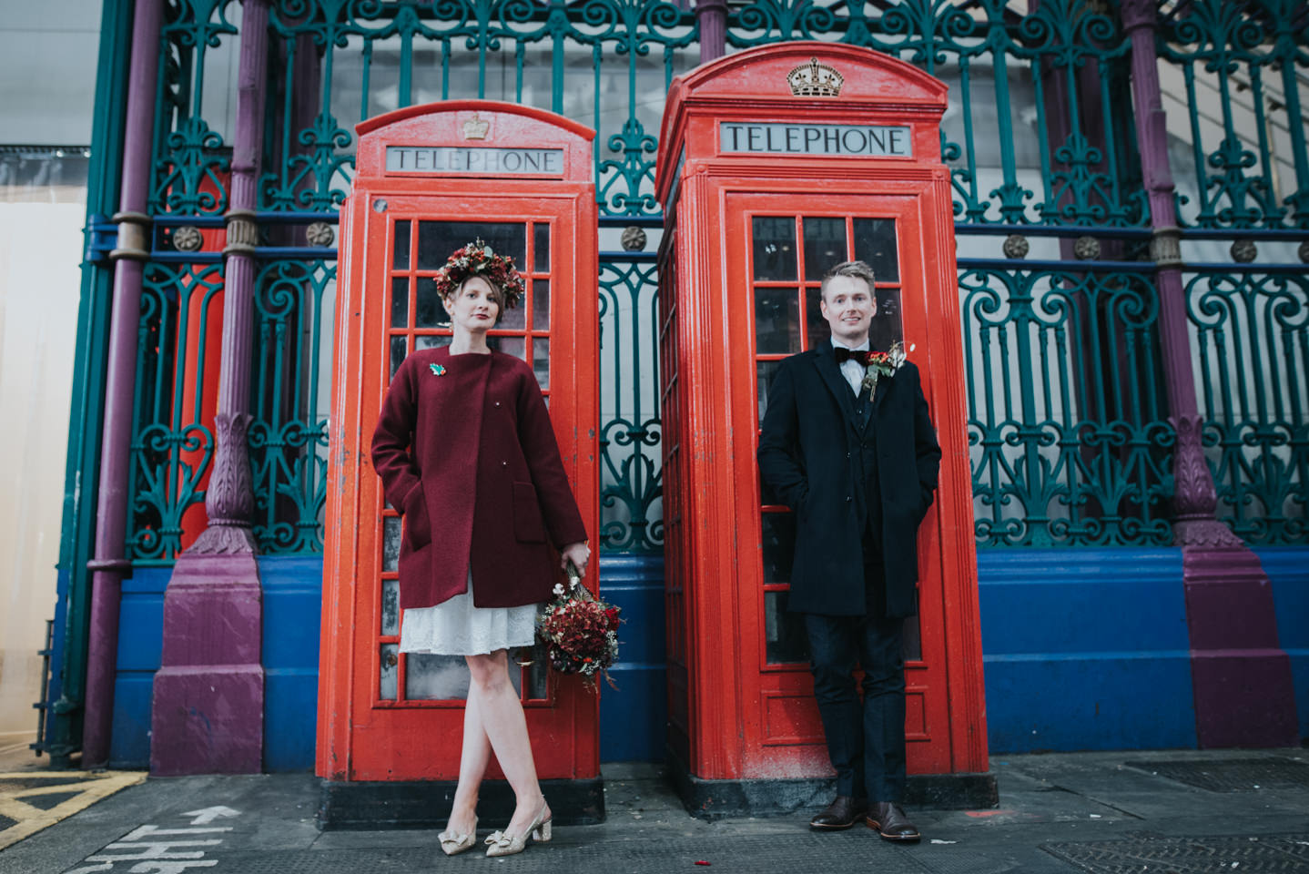 couple in front of london phone boxes