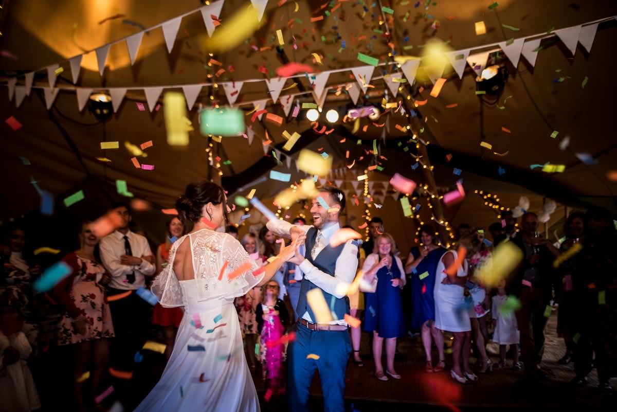 couple in a tipi with confetti canon